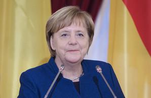 Меркель обсудила с Путиным реализацию минских соглашений